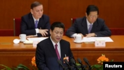 China's newly-elected President Xi Jinping delivers a speech during the closing session of the National People's Congress in Beijing March 17, 2013.
