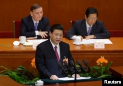 Newly-elected President Xi Jinping delivers a speech during the closing session of the National People's Congress in Beijing, March 17, 2013.