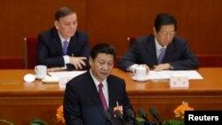ປະທານປະເທດທີ່ຖືກເລືອກໃໝ່ຂອງຈີນ ທ່ານ Xi Jinping ກ່າວຄຳປາໄສ ໃນລະຫວ່າງປິດກອງປະຊຸມ ສະພາປະຊາຊົນ ແຫ່ງຊາດ ທີ່ຫໍສາລາປະຊາຊົນ ໃນກຸງປັກກິ່ງ (17 ມີນາ 2013)