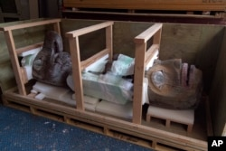 A totem pole carved by the Alaskan Tlingit Tribe is boxed up at the Honolulu Museum of Art, Oct. 22, 2015, in Honolulu.