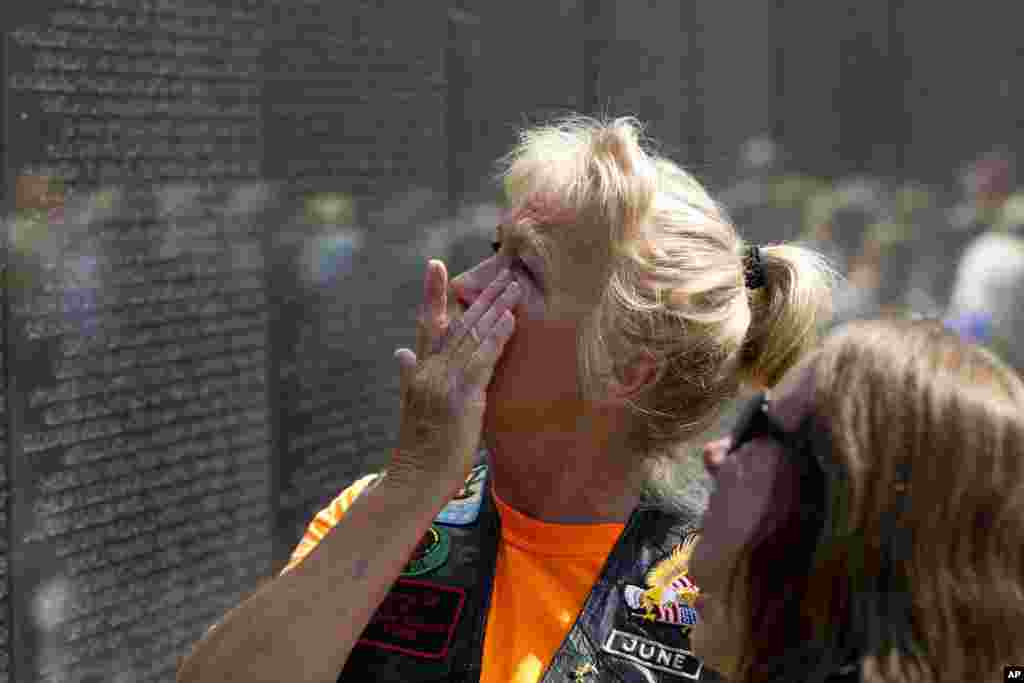 June Allums Flowers looks at the name of her brother Allen W. Allums at Vietnam Veterans Memorial wall ahead of Memorial Day, May 27, 2018, in Washington.