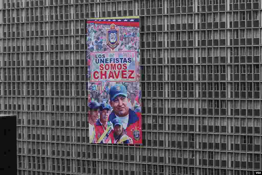 A government building in Caracas displays a poster with an image of the late Venezuelan president Hugo Chavez.