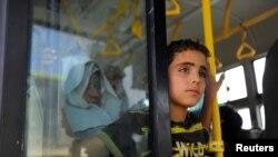 Evakuasiya olunanlar arasında uşaqlar var. 26 avqust, 2016.