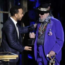 Dr. John, right, is presented his trophy by John Legend at the Rock and Roll Hall of Fame induction ceremony