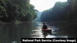 A person kayaks on the Green River