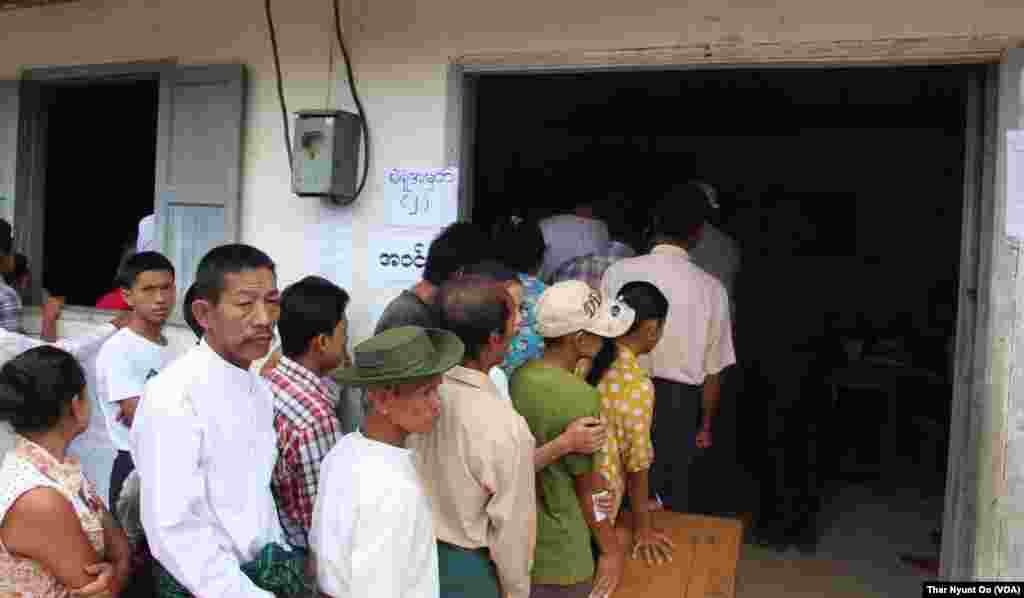Voters are seen at a polling station in Yangon, Nov. 8, 2015.