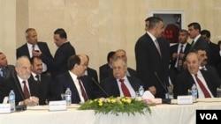 Mantan PM Irak Ibrahim Jafari, PM Irak Nouri al-Maliki, Presiden Irak Jalal Talabani and Mantan PM Irak Iyad Allawi saat bertemu di Baghdad 8 November.