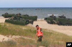 NATO troops make a massive amphibious landing during NATO sea exercises BALTOPS 2015 in Ustka, Poland, June 17, 2015.