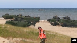 NATO troops make massive amphibious landing during sea exercises to reassure Baltic Sea region allies in the face of a resurgent Russia, in Ustka, Poland, June 17, 2015.