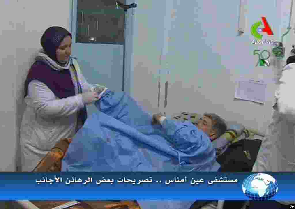 An unidentified former hostage receives treatment in a hospital in Ain Amenas, Algeria, in this image taken from television, January 18, 2013. (Canal Algerie)