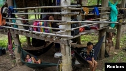 Villagers who fled Myanmar's Ee Thu Hta displacement camp rest in Mae Hong Son province, Thailand, near the border while fleeing from gunfire between ethnic minority Karen insurgents and Myanmar military, April 29, 2021.