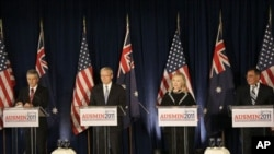 From left, Australian Defense Minister Stephen Smith, Australian Foreign Minister Kevin Rudd, Secretary of State Hillary Clinton, and U.S. Defense Secretary Leon Panetta speak at a news conference at AUSMIN 2011 in San Francisco, Thursday, Sept. 15, 2011.