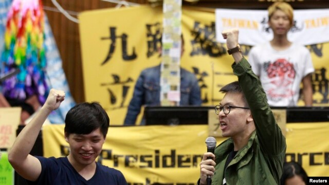 FILE - Student leaders chant slogans inside Taiwan's legislative Yuan, Taiwan's parliament, after a visit from Legislative Speaker Wang Jin-pyng and lawmakers from both the Nationalist Party (KMT) and opposition Democratic Progressive Party (DPP) in Taipe