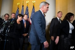 FILE - House Majority Leader Kevin McCarthy of California leaves a news conference after dropping out of the race to replace House Speaker John Boehner, on Capitol Hill in Washington, Oct. 8, 2015.