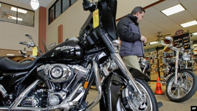 Customers admire and look at the new Harley-Davidson motorcycles at the Hall's Harley Davidson dealership in Springfield, Ill. Harley-Davidson's second-quarter profit more than doubled as it posted its first U.S. sales increase since 2006, (File)