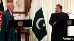 Pakistan's Prime Minister Nawaz Sharif (R) speaks during a joint news conference as Afghan President Hamid Karzai listens at the prime minister's residence in Islamabad, Aug. 26, 2013.