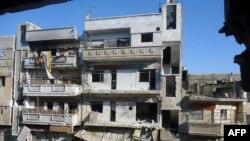 A handout picture released by the Syrian opposition's Shaam News Network on July 13, 2012 shows destruction in Homs Karm Shamsham neighbourhood on July 12, 2012. (AFP/Shaam News Network)