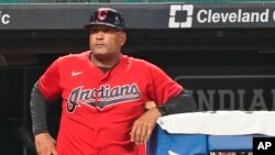 Cleveland Indians' Sandy Alomar Jr. waits to walk on the field during a baseball game against the Kansas City Royals, Sept. 21, 2021, in Cleveland.