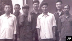 Khmer Rouge cadre with Chinese advisors standing in front of Hotel Le Phnom.