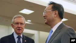 U.S. Senate Majority Leader Harry Reid, D-Nev., left, is greeted by Chinese Foreign Minister Yang Jiechi at Foreign Ministry in Beijing Wednesday, April 20, 2011