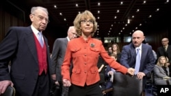 Former Arizona Rep. Gabrielle Giffords was seriously injured in the mass shooting that killed six people in Tucson, Arizona. She arrives on Capitol Hill in Washington for a hearing on gun laws.