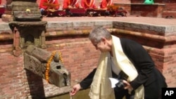 Ambassador Nancy J. Powell, Director General of the Foreign Service and Director of Human Resources, enjoying the water of Nag Bahal Hiti, a traditional Nepalese water spout restored by the Ambassadors Fund for Cultural Preservation. (file)
