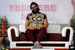 FILE - In this May 17, 2017 file photo, an Indian spiritual guru, who calls himself Saint Dr. Gurmeet Ram Rahim Singh Ji Insan, attends the premiere of the movie 'Jattu Engineer' in New Delhi, India.