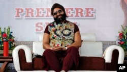 FILE - In this May 17, 2017 file photo, an Indian spiritual guru, who calls himself Saint Dr. Gurmeet Ram Rahim Singh Ji Insan, attends the premiere of the movie 'Jattu Engineer' in New Delhi, India.