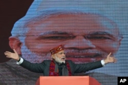 Indian Prime Minister Narendra Modi addresses a political gathering of his Bharatiya Janata Party, in Himachal Pradesh, in Dharmsala, Dec. 27, 2018.