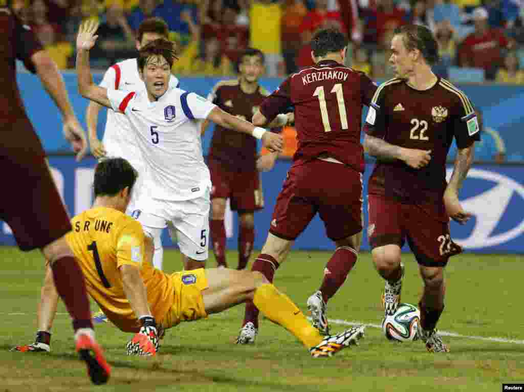 Russia's Alexander Kerzhakov (No. 11) is seen in action before scoring the goal against South Korea during their 2014 World Cup Group H soccer match at the Pantanal arena, in Cuiaba, June 17, 2014.