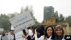 The sign at the Beirut demonstration says: 'The man... supports the law to protect women from violence'