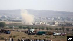 伊斯兰国激进武装的坦克炮轰科巴尼镇中心