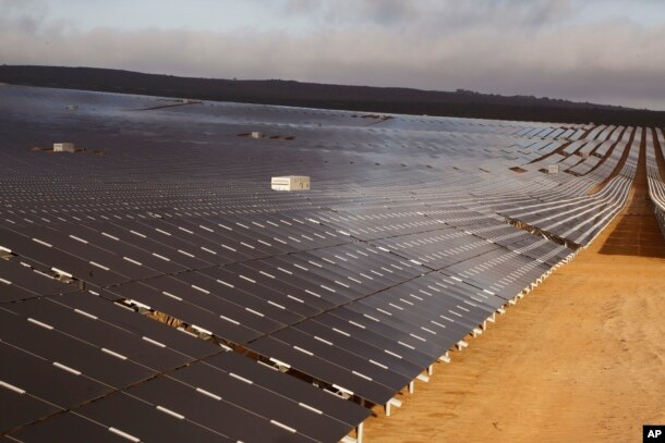 FILE - A photovoltaic solar park situated on the outskirts of the coastal town of Lamberts Bay, South Africa.
