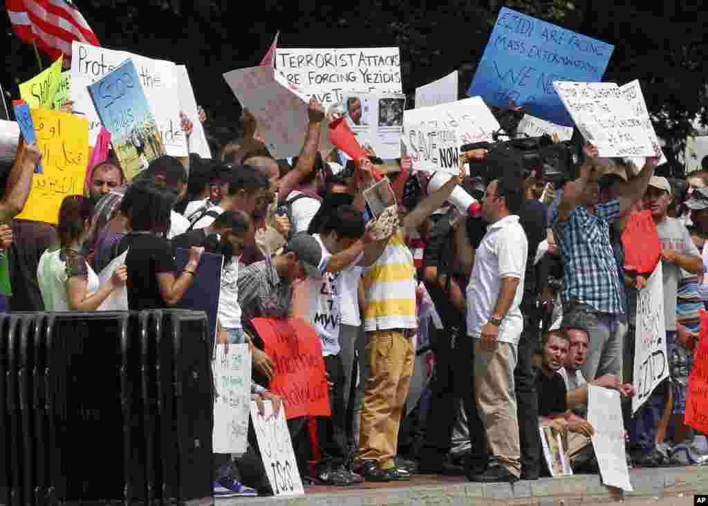 Demonstrators ask for help for Yazidi people who are stranded by violence in northern Iraq, across from the White House in Washington, DC, Aug. 7, 2014.
