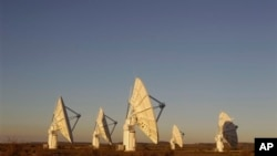 Radio telescopes like these near Carnarvon, South Africa are used to study radio signals from throughout the universe.