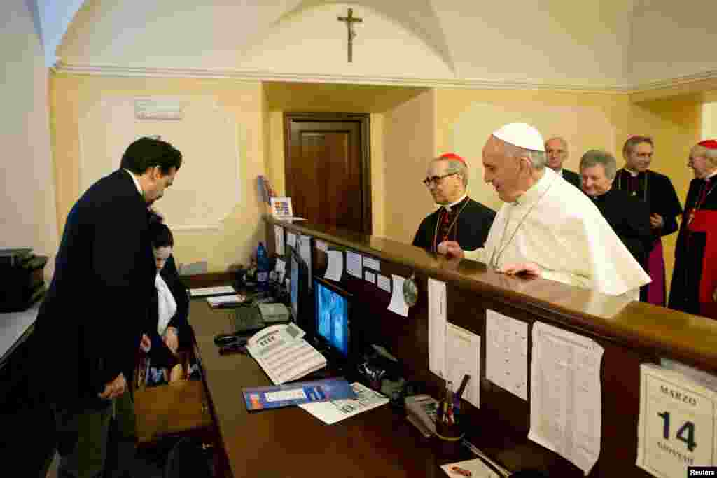 Pope Francis checks out of the church-run residence where he had been staying in Rome before becoming pontiff, March, 14, 2013. (Osservatore Romano)