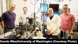 This instrument built by UW engineers (from left) Peter Pauzauskie, Xuezhe Zhou, Bennett Smith, Matthew Crane and Paden Roder (unpictured) used infrared laser light to refrigerate liquids for the first time.
