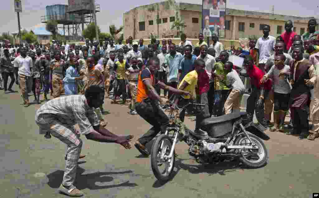 Supporters of opposition candidate Gen. Muhammadu Buhari's All Progressives Congress (APC) party celebrate by wheel-spinning motorcycles what they said was the senatorial win in Kano Central district of APC candidate Rabiu Musa Kwankwaso. Nigerians are waiting in hope and fear for results of the most tightly contested presidential election in the nation's turbulent history.