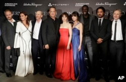 FILE - From left, Ben Foster, Sidse Babett Knudsen, director Ron Howard, Tom Hanks, Ana Ularu, Felicity Jones, Omar Sy, Irrfan Khan, and writer Dan Brown, pose at the premiere of the movie 'Inferno,' based on a novel by Dan Brown, at the opera house in Florence, Italy.