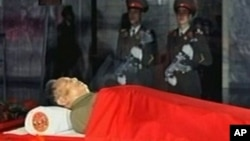 The body of North Korean leader Kim Jong Il is laid in a memorial palace in Pyongyang, North Korea, December 20, 2011.