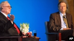 Warren Buffett and Bill Gates from a news conference in Beijing