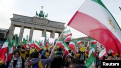 People demonstrate in support of protests across Iran, Jan. 6, 2018, in front of the Brandenburg Gate in Berlin.
