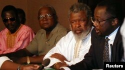 "Sierra Leone's rebel leader Foday Sankoh (2nd R) is flanked by senior aides at the formal opening in Lome, Togo of talks. Others (from left) are Sankoh's military adviser General Ibrahim Bah, Solomon ""Pa"" Rogers and Omrie Golley, (File photo)."