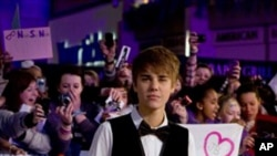 US singer Justin Bieber arrives for the European premiere of his film 'Never Say Never', Wednesday, Feb. 16, 2011, held at the o2 in London. (AP Photo/Joel Ryan)