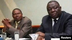 Zimbabwe Movement For Democratic Change (MDC) leader Morgan Tsvangirai (R) and Simba Makoni (L) of the Mavambo/Dawan/Kusile (MDK) party address a news conference in Harare, July 8, 2013.