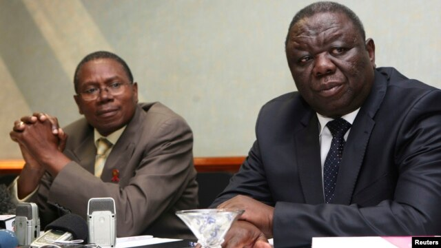 Zimbabwe Movement For Democratic Change (MDC) leader Morgan Tsvangirai (R) and Simba Makoni (L) of the Mavambo/Dawan/Kusile (MDK) party address a news conference in Harare, July 8, 2013.