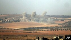 Smoke rises from the Syrian side of the border, in a photo taken from Karkamis, Turkey, Aug. 24, 2016.