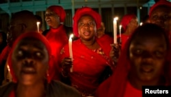 People hold candles and pray in Abuja, the capital, during a vigil calling for the release of Nigerian schoolgirls abducted in the remote village of Chibok, Nigeria, May 15, 2014.