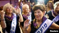 Holocaust survivor Carmela Ben Yehuda, 89, dances during the annual Holocaust survivors' beauty pageant in the Israeli city of Haifa, Oct. 30, 2016.