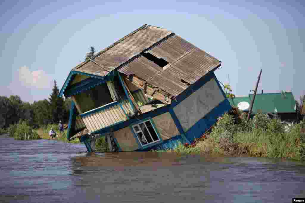 Destroyed house is seen in a flood-affected town of Tulun in Irkutsk Region, Russia.
